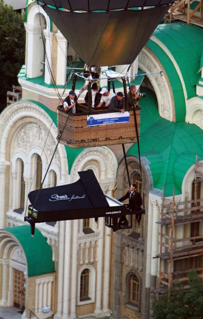 piano floating in a baloon vilnius lithuania