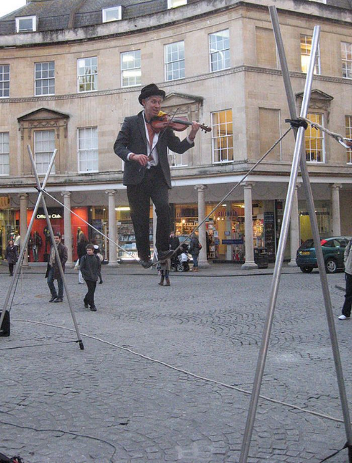 tightrope walking violin player