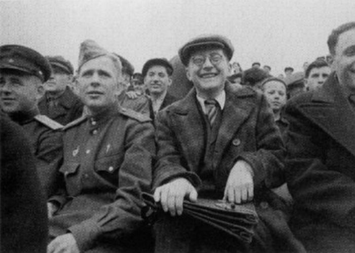 Dmitri Shostakovich looking happy watching soccer